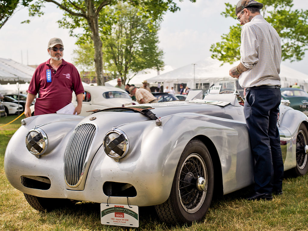 two men judging silver vintage car at Greenwich Concours